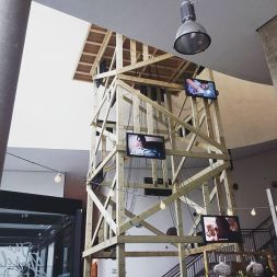 James Coupe examines the power and meaning of surveillance in our everyday life. His four-storey wooden watchtower, A Machine for Living, occupies the main atrium at FACT, and hires online workers to perform tasks that reveal the shifting nature of our relationship with observational structures.